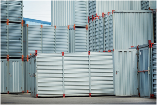 Multiple gray storage containers stacked together.