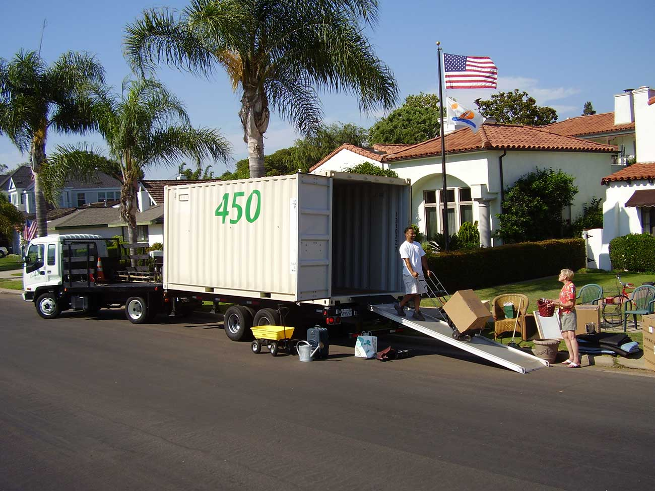 A photo of a person unloading items from a Coronado Mobile Storage container in San Diego
