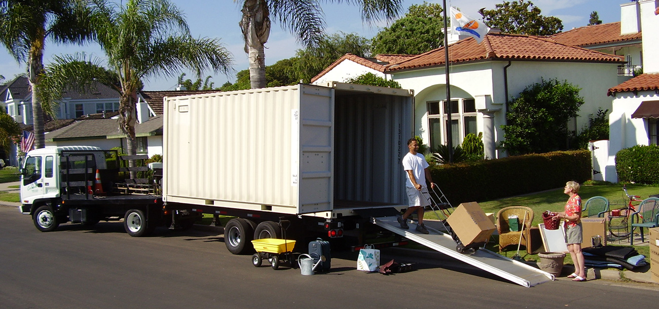 Photo of a person unloading a portable self storage container in San Diego