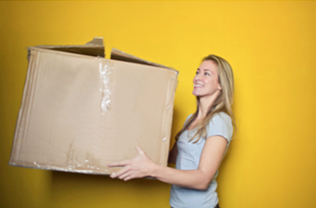 Woman holding moving box in San Diego